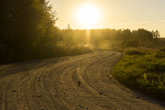 Rural dirt road at sunset Royalty Free Stock Photography