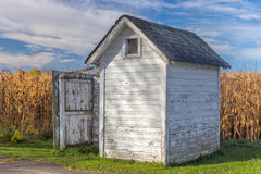 Rural Distressed White Outhouse Royalty Free Stock Photography