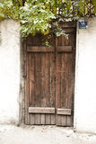 Rural door. Closed back door Royalty Free Stock Images