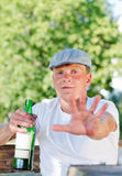 Rural drunk protesting being photographed Royalty Free Stock Photo