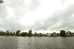 Rural dutch scenery of small old houses and canal in Zaanse, Net Stock Image