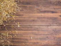 Rural eco background with straw on the background of old wooden planks. The view from the top. Creative background for Stock Images