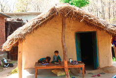 Rural education. Image describes the implementation of rural education programme in india. Village children studying in front of their house Royalty Free Stock Image