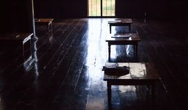 Rural Education in developing countries, study room indoors full with small wooden desks, no modern devices on lacquered wooden. Floor. Self Sufficiency royalty free stock images