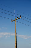 Rural electrical post by the road Royalty Free Stock Photo