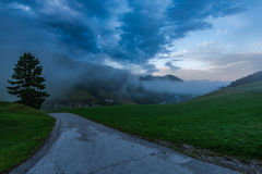Rural empty road leading to Sorica village in Slovenia.  royalty free stock images
