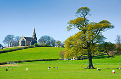 Rural English church. Scenic view of Bardsea church in the green English countryside, Cumbria, U.K Royalty Free Stock Photography