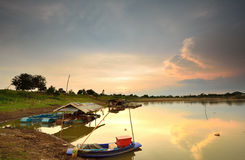 Rural evening with fishermen Stock Photography