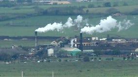 Rural factory zoom stock footage