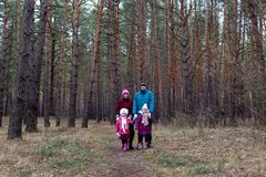 Rural family in autumn forest.  Royalty Free Stock Photos