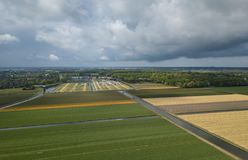Rural farm fields with natural food growing in Netherlands. Aerial drone shot of agricultural fields with crops growing in rural province of Kingdom of royalty free stock photo