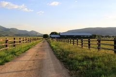 Rural farm road in Utah, USA. Royalty Free Stock Images