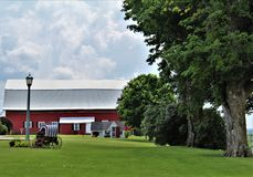 Farm located in Franklin County, upstate New York, United States. Rural farm with surrounding green vegetation located in Franklin County, upstate New York royalty free stock photos