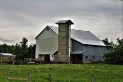 Farm located in Franklin County, upstate New York, United States. Rural farm with surrounding green vegetation located in Franklin County, upstate New York royalty free stock image