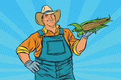Rural farmer with an ear of corn. Pop art retro vector illustration. Agriculture and the harvest Royalty Free Stock Image