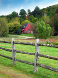 Rural Farmhouse. Red barn or farmhouse located in a rural area Stock Images