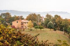 Rural farmhouse in tuscan countryside landscape, Tuscany, Italy. Europe Royalty Free Stock Photography
