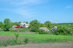 Rural farmland. View to the farmland in early spring during the arable work Royalty Free Stock Photo