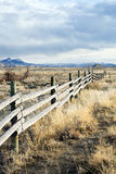 Rural fence. Running through barren Wyoming landscape Stock Images