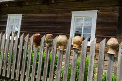 Rural fence with old cracked earthen jars outdoor Royalty Free Stock Image