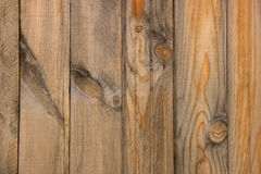 Rural fence from wooden planks with knots. Wood texture Royalty Free Stock Photo