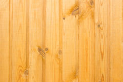 Rural fence from wooden planks with knots. Wood texture Stock Photography