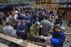 Rural festivities, villagers drink alcohol and take their food t Royalty Free Stock Photography