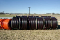 Rural Fiber Optic. Fiber optic cable ready to be laid in a rural area with an old barn and silo in background stock photography