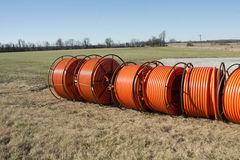 Rural Fiber Optic. Fiber optic cable ready to be laid in a rural area with an old barn and silo in background royalty free stock images