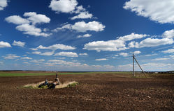 Rural field in spring. With the installation of irrigation Stock Images