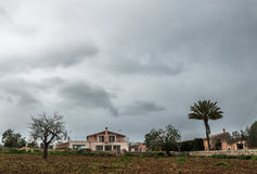 A rural finca in Majorca front view on a cloudy day Stock Photos