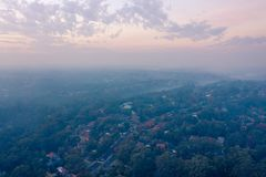 Rural Fire Services RFS Hazard reduction burns create smoke and haze over Sydney basin, reducing visibility and increasing risk royalty free stock image