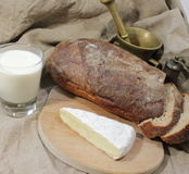 Rural food. Black bread and milk Royalty Free Stock Images