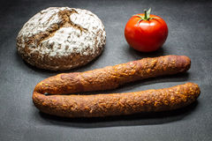 Rural food. Bread rural, country sausage, tomato Royalty Free Stock Images