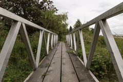 Rural Foot Bridge. A People Bridge That Goes Over A Countryside Stream stock photo