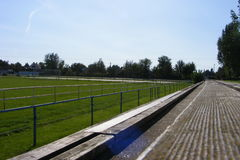 Rural football, soccer pitch taken from the grandstand on a sunny spring, summers day. Stock Photos