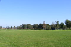Rural football, soccer pitch taken from the grandstand on a sunny spring, summers day. Rural football, soccer pitch taken from the grandstand, in Europe stock photography