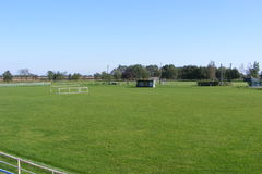 Rural football, soccer pitch taken from the grandstand on a sunny spring, summers day. Royalty Free Stock Photos