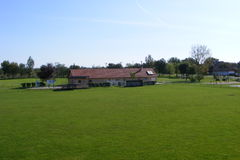 Rural football, soccer pitch taken from the grandstand on a sunny spring, summers day. Royalty Free Stock Images