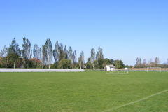 Rural football, soccer pitch taken from the grandstand on a sunny spring, summers day. Royalty Free Stock Image