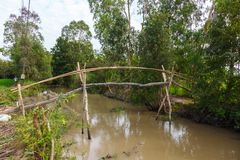 Rural footbridge of sticks and tree branches Stock Image