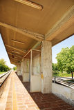 Rural Friullian Train Station. A single-line train station in the village of Moimacco, Friuli, north east Italy. Thi is a request stop, and the red light shows royalty free stock photo