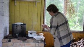 Rural furnace pot woman stock video