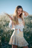 Rural girl with buch of feather grass Royalty Free Stock Photography