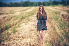 Rural girl in field Royalty Free Stock Photo