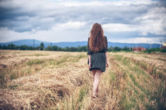 Rural girl in field Stock Image
