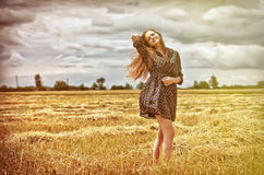 Rural girl in field Royalty Free Stock Images