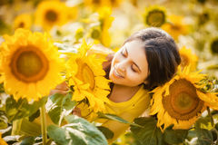 Rural girl in field sunflowers Stock Photo