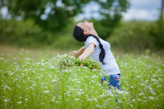 Rural girl in the field Stock Images