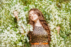Rural girl in flowers Stock Images